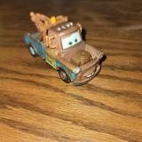Disney Toys | Disney Pixar Cars 2 Race Team Mater Tow Truck Die | Color: Brown | Size: Osb