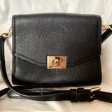 Michael Kors Bags   Black Leather Micheal Kors Purse.   Color: Black   Size: L 5.25 W 6.5