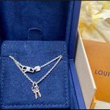 Louis Vuitton Jewelry | Louis Vuitton 18kt White Gold Chain Keys Necklace | Color: Gold/White | Size: 16