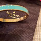 Kate Spade Jewelry   Kate Spade Like Hotcakes Teal Aqua Idiom Bangle With Bag And Box   Color: Blue/Gold   Size: Os