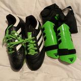 Adidas Shoes   Adidas Kids Soccer Cleats And Shin Guards   Color: Black   Size: Youth 2