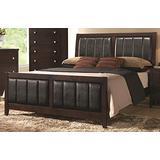 Coaster Carlton Eastern King Size Panel Bed with Black Padded Leatherette Tapered Legs Solid Wood and Veneers Construction, In Cappuccino