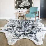 Novogratz Khalhari Animal Print Handmade Tufted Black/White Area RugPolyester in Black/Brown/White, Size 114.0 H x 90.0 W x 1.0 D in | Wayfair