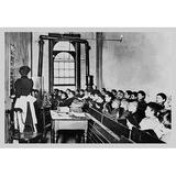 """Buyenlarge 'Teacher Instructs Students from Blackboard in Classroom' Photographic Print in Brown/White/Black, Size Small 18""""-24"""" 
