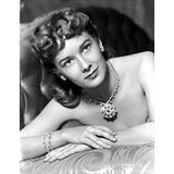 Vera Miles photographed wearing dazzling diamond encrusted earring and braclets to match a diamond necklace adorned with an intricate large diamond pendant Photo Print (24 x 30)