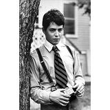 Matthew Broderick wearing suspenders and a striped tie outdoors Photo Print (24 x 30)