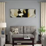 East Urban Home 'Close-Up of Calla Lily Flowers Growing on Plant II' Photographic Print on CanvasCanvas & Fabric in Black/Brown/Green | Wayfair