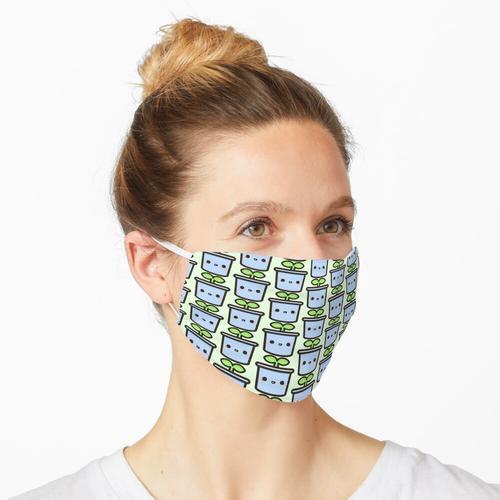 Niedlicher Spross im Topf Maske