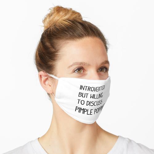 Introvertiert, aber bereit, über Pickelknallen zu diskutieren Maske